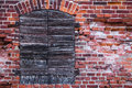 Crumbling brick wall of an old german warehouse with closed shutters fragment a and wooden Stock Photo