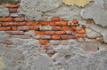 Crumbling plaster wall a reveals a brick core Stock Photography