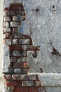Crumbling wall of brick and plaster Royalty Free Stock Photo
