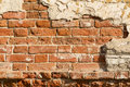 Crumbling wall of red brick Royalty Free Stock Photo