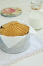 Crumbly cookies in tin box on vintage doily lace light background Stock Photo