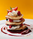 Crumpets with raspberry sauce whipped curd cheese and roasted almonds Royalty Free Stock Photos