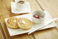 Crumpets toasted on white dish and wooden table top Royalty Free Stock Photo