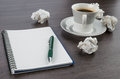 Crumple paper notebook and pen with cup of coffee on the desk Royalty Free Stock Photos