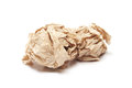 Crumpled brown tissue paper ball on white background Stock Images