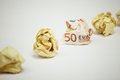 Crumpled euro bill amound office paper Royalty Free Stock Photo