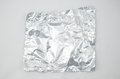 Crumpled foil on white background Royalty Free Stock Photo