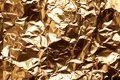 Crumpled gold foil as background