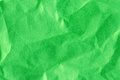 Crumpled green cloth coloured or paper surface Royalty Free Stock Image