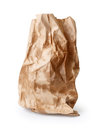 Crumpled paper bag with grease spots isolated on white Stock Images