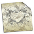 Crumpled paper with drawings of hearts Stock Photo
