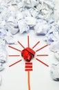 Crumpled paper light bulb metaphor for good idea