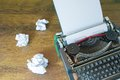 Crumpled paper and typewriter old on wooden desk Stock Photos