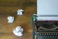 Crumpled paper and typewriter old on wooden desk Stock Images