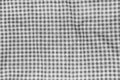 Crumpled tablecloth abstract background texture of a black and white checkered picnic blanket Royalty Free Stock Photo