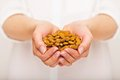 Crunchy almonds for your snack woman with a pile of in her hands Stock Photo
