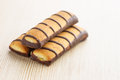 Crunchy biscuits on wooden table Stock Photo