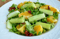 Crunchy green salad with pecans and sweet lime cucumber served fresh a dash of Stock Photography