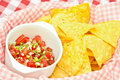 Crunchy nachos mexican chips with tomato salsa Royalty Free Stock Photos