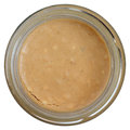 Crunchy peanut butter glass jar of shot from above Stock Photo