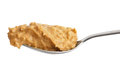 Crunchy peanut butter on metal spoon Royalty Free Stock Photo
