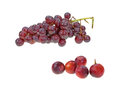 Crunchy red grapes a stalk of seedless with five single in the foreground Royalty Free Stock Images