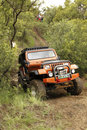 Crush beige jeep wrangler off roader v bafokeng march crossing obstacle at leroleng x track on march in bafokeng rustenburg south Stock Image