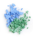 Crushed eye shadows blue and green on white background Stock Images