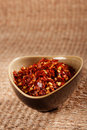 Crushed red hot chilli pepper in bowl Royalty Free Stock Image