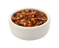 Crushed red pepper bowl isolated white clipping path Stock Images
