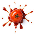 Crushed tomato splattered with ketchup isolated on white background Royalty Free Stock Image