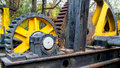 Crushing force the grooves of two big and old rusted gears lined up into place Stock Photos