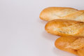 Crusty french baguettes three on white Royalty Free Stock Photo