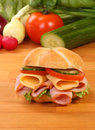 Crusty white roll filled with ham and salad Royalty Free Stock Photo