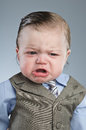 Cry baby businessman a month old dressed in a suit Stock Image
