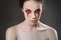 Cry portrait of a female vampire over black background Royalty Free Stock Photo