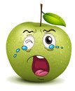 Crying apple smiley Royalty Free Stock Images