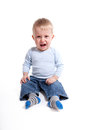 Crying baby boy in front of white background Royalty Free Stock Photos