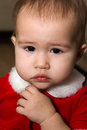 Crying baby girl young in her christmas dress Stock Photos