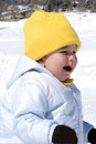 Crying baby on the snow Royalty Free Stock Images