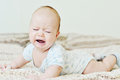 Crying baby sweet laying on the sofa Royalty Free Stock Image