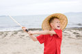 Crying boy plays with samurai sword Royalty Free Stock Image