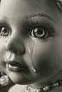 Crying doll close up of Stock Photography