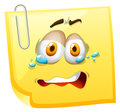 Crying face on yellow paper Royalty Free Stock Photo