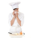 Crying female cook in white uniform cutting onion Stock Photo