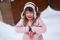 Crying girl in the pink jacket gently freezing outside in winter Royalty Free Stock Photo