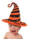 Crying halloween baby wearing a witch hat Stock Photography