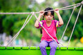 Crying little asian girl sitting alone on a playground outdoor Royalty Free Stock Photo