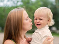 Crying Little Boy who is Being Held by her Mother Royalty Free Stock Photo