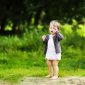 Crying little child in a park Royalty Free Stock Photo
